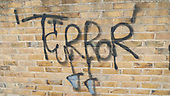 "London, England. ""Terror"" graffitti on wall."