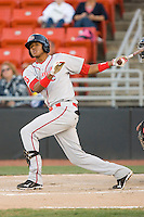 Michael Almanzar #25 of the Greenville Drive follows through on his swing against the Hickory Crawdads at  L.P. Frans Stadium May 8, 2010, in Hickory, North Carolina.  Photo by Brian Westerholt / Four Seam Images