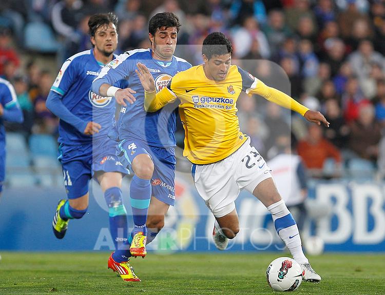 Getafe's Miguel Torres (l) and Real Sociedad's Carlos Vela during La Liga match.March 17,2012. (ALTERPHOTOS/Acero)