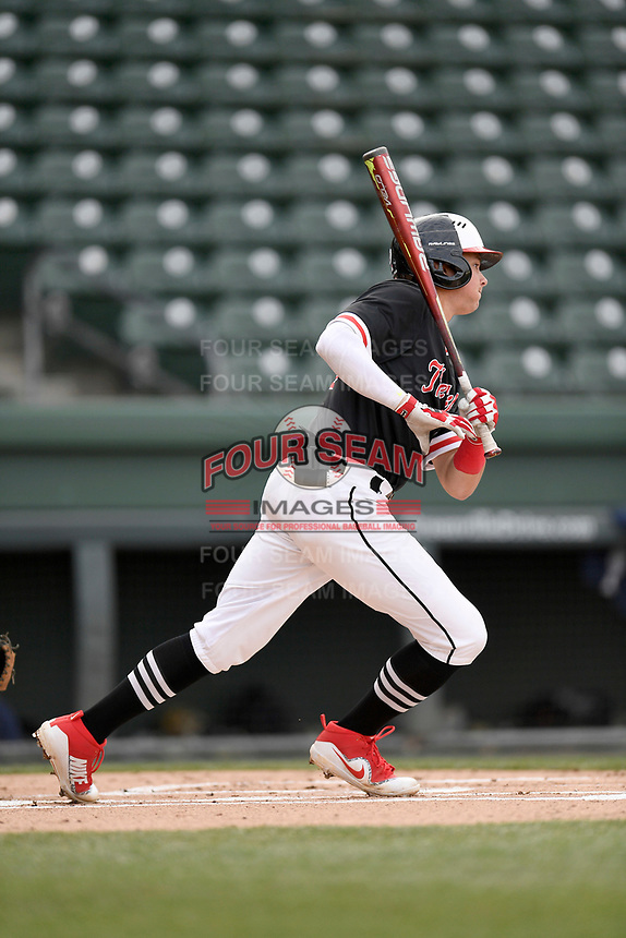 Shortstop Utah Jones (2) of the North Greenville Crusaders bats in a game against the Queens University Royals on Tuesday, March 12, 2019, at Fluor Field at the West End in Greenville, South Carolina. North Greenville won, 14-3. (Tom Priddy/Four Seam Images)