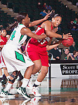 North Texas Mean Green forward Jasmine Godbolt (24) and Louisiana Lafayette Ragin' Cajuns center Josie West (23) in action during the game between the Louisiana Lafayette Ragin' Cajuns and the University of North Texas Mean Green at the North Texas Coliseum,the Super Pit, in Denton, Texas. UNT defeats Louisiana Lafayette 78 to 40....