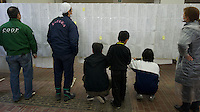 People look at ....the lists in the town-hall of Natori, near Sendai, Japan, hoping to see the names of missing relatives. The Tsunami devastated the entire pacifc coastline of Japan after the earthquake and tsunami devastated the area Sendai, Japan. It is one of the biggest earthquakes ever recorded struck off the coast of Japan on 11 Mar 2011 had killed thousands of people. The death toll was expected to rise dramatically, with tens of thousands reported missing..16 Mar 2011..