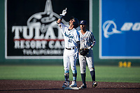 Everett AquaSox second baseman Cesar Izturis Jr. (40) celebrates in front of Kelvin Alarcon (1) after getting a hit during a Northwest League game against the Tri-City Dust Devils at Everett Memorial Stadium on September 3, 2018 in Everett, Washington. The Everett AquaSox defeated the Tri-City Dust Devils by a score of 8-3. (Zachary Lucy/Four Seam Images)