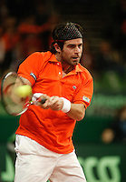10-2-06, Netherlands, tennis, Amsterdam, Daviscup.Netherlands Russia, Raemon Sluiter in action against Dmitry Tursonov i
