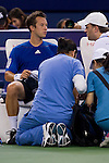 SHANGHAI, CHINA - OCTOBER 12:  Philipp Kohlschreiber of Germany receives medical attention during his match against Andy Roddick of USA during day two of the 2010 Shanghai Rolex Masters at the Shanghai Qi Zhong Tennis Center on October 12, 2010 in Shanghai, China.  (Photo by Victor Fraile/The Power of Sport Images) *** Local Caption *** Philipp Kohlschreiber