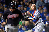 Chicago Cubs catcher David Ross (3) throws Jason Kipnis (left) out at first after a bunt attempt in the fourth inning during Game 5 of the Major League Baseball World Series against the Cleveland Indians on October 30, 2016 at Wrigley Field in Chicago, Illinois.  (Mike Janes/Four Seam Images)