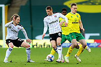 20th February 2021; Carrow Road, Norwich, Norfolk, England, English Football League Championship Football, Norwich versus Rotherham United; Ben Wiles of Rotherham United takes on Oliver Skipp of Norwich City
