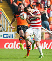 Dundee Utd's Keith Watson and Hamilton's Anthony Andreu challenge for the ball.