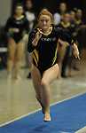Towson University's Alexa Davis competes on the vault during the Shelli Calloway Memorial Gymnastics Invitational at Towson University in Towson, Maryland.