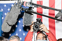 Boom mics hang above the activity as Texas senator and Republican presidential candidate Ted Cruz speaks to the media before a speech at The Village Trestle restaurant in Goffstown, New Hampshire, on Wed., Feb. 3, 2016.
