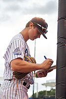 Tampa Tarpons Trey Sweeney (4) signs autographs before a game against the Clearwater Threshers on August 10, 2021 at George M. Steinbrenner Field in Tampa, Florida.  (Mike Janes/Four Seam Images)