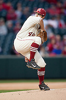 Arkansas Razorbacks pitcher Jalen Beeks (49) winds up on the mound at Baum Stadium during the NCAA baseball game against the Alabama Crimson Tide on March 21, 2014 in Fayetteville, Arkansas.  The Alabama Crimson Tide defeated the Arkansas Razorbacks 17-9.  (William Purnell/Four Seam Images)