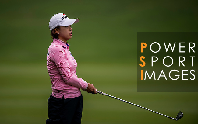 Hyeon-Seo Kang of Korea in action during the Hyundai China Ladies Open 2014 on December 12 2014 at Mission Hills Shenzhen, in Shenzhen, China. Photo by Li Man Yuen / Power Sport Images