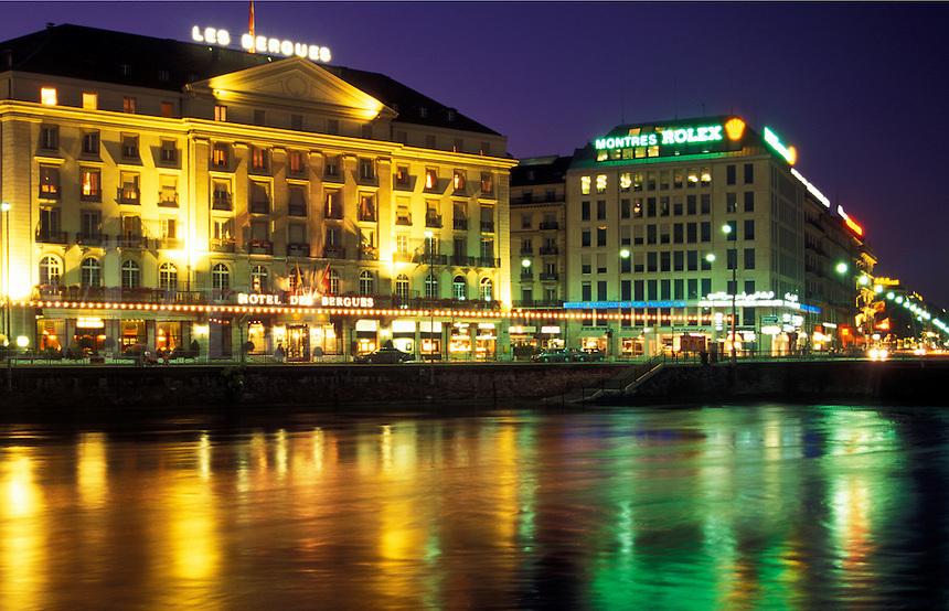 Geneva, Rhone River, Switzerland, Buildings along the Rhone River in downtown Geneva at night.