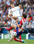 Real Madrid's Garet Bale (c) and Atletico de Madrid's Tiago Cardoso (b) and Diego Godin during the UEFA Champions League 2013/2014 Final match.May 24,2014. (ALTERPHOTOS/Acero)