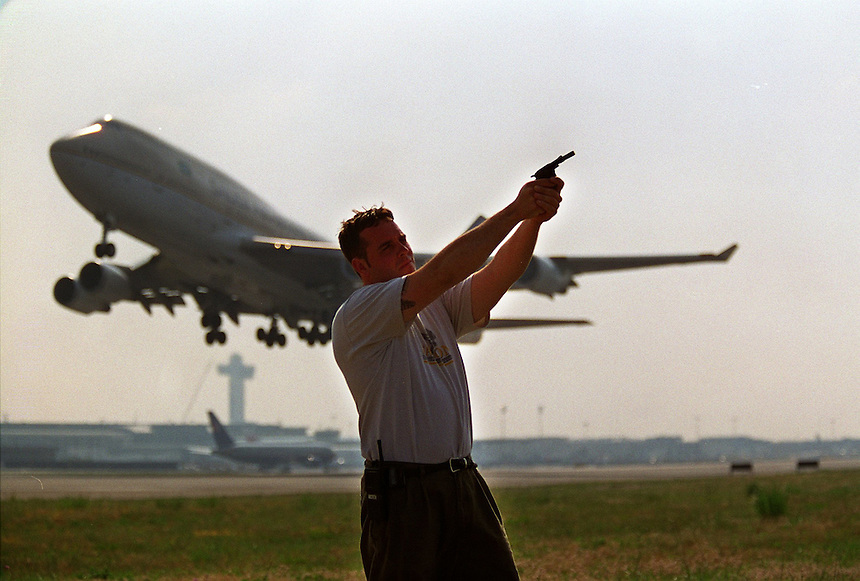In an attempt to reduce presence of gulls which can get sucked into jet engines, Mike Farley (Seaford) employs pyrotechnic launcher.  The sound often scares away gulls.  747 takes off from runway 31L..Newsday/ARI MINTZ 7/10/00