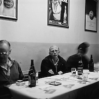 Harold sits at a table drinking a bottle of Carling Black Label in the Harlequins Sports Bar on Pretoria Street.