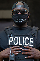 A member of the D.C. police force only identified as Officer Stewart stands outs of AFL-CIO headquarters during a march against police brutality and racism in Washington, D.C. on Saturday, June 6, 2020.<br /> Credit: Amanda Andrade-Rhoades / CNP/AdMedia