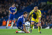 Gal Alberman of Maccabi Tel Aviv beats Cesc Fabregas of Chelsea to the ball during the UEFA Champions League match between Chelsea and Maccabi Tel Aviv at Stamford Bridge, London, England on 16 September 2015. Photo by Andy Rowland.