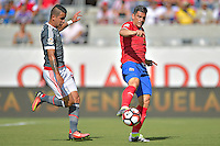 Action photo during the match Costa Rica vs Paraguay, Corresponding Group -A- America Cup Centenary 2016, at Citrus Bowl Stadium<br /> <br /> Foto de accion durante el partido Estados Unidos vs Colombia, Correspondiante al Grupo -A-  de la Copa America Centenario USA 2016 en el Estadio Citrus Bowl, en la foto: (i-d) Derlis Gonzalez de Paraguay  y  Johnny Acosta de Costa Rica<br /> <br /> <br /> <br /> 04/06/2016/MEXSPORT/Isaac Ortiz.