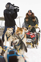 Warren Palrey is interviewed by the Iditarod Insider crew as he arrives at the Nikolai checkpoint on Tuesday during Iditarod 2008