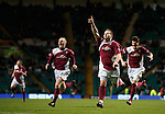 Arbroath's Steven Doris celebrates after scoring from a free-kick and is chased by team-mates Brian Kerr and Stewart Malcolm