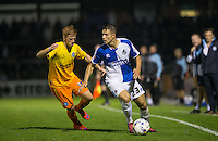 Billy Bodin of Bristol Rovers looks for options under pressure from Ryan Sellers of Wycombe Wanderers during the Johnstone's Paint Trophy match between Bristol Rovers and Wycombe Wanderers at the Memorial Stadium, Bristol, England on 6 October 2015. Photo by Andy Rowland.