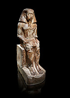 Ancient Egyptian statue of Wahka son of Neferhoptep, Middle Kingdom, 13th Dynasty, (1760 BC), Qaw el-Kebir, Tomb 7. Egyptian Museum, Turin. black background. <br /> <br /> This exceptional example of a private sculpture depicts a provincial official in almost Royal size and attitude. It was found inside the largest funerary chapel in Qaw el-Kebir, built of governor Wahka II around 1850 BC, The style indicates a date about a century later at a time when local governors did not build large tombs anymore. The statue was therefore installed by another Wahka into his ancestors chapel to keep the memory of his glorious lineage alive. Schiapelli excavations Cat 4265.