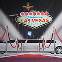 Backdrop featuring Limousine and formal red carpet with Las Vegas, Nevada sign at celebrity grand opening event