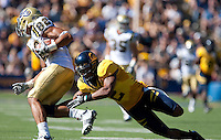 Marc Anthony extends to make the defensive play on Taylor Embree. The California Golden Bears defeated the UCLA Bruins 35-7 at Memorial Stadium in Berkeley, California on October 9th, 2010.