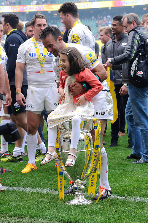 Neil de Kock of Saracens shares a special moment with his daughter after winning the Aviva Premiership Rugby Final between Bath Rugby and Saracens at Twickenham Stadium on Saturday 30th May 2015 (Photo by Rob Munro)
