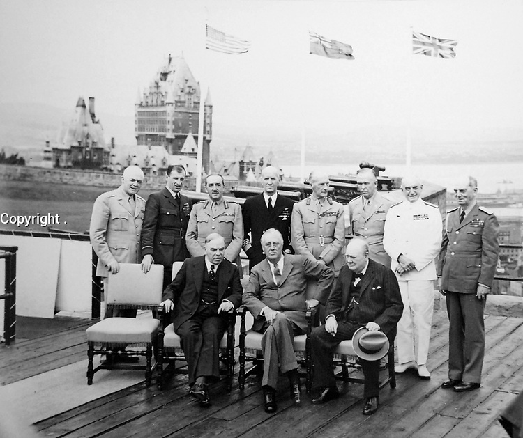 Allied Conference at Quebec, Canada. Seated, left to right: Canadian Prime Minister MacKenzie King; President Franklin D. Roosevelt and Winston Churchill, British Prime Minister. Standing, left to right: General H.H. Arnold; Chief of U.S. Air Forces; Air Chief Marshall, Sir Charles Portal of Great Britain; General Sir Alan Brooke, Chief of the Imperial General Staff; Admiral E. J. King, Chief of U.S. Naval Forces; Field Marshall Sir John Dill, Chief of Joint Staff Mission at Washington, D.C.; General George C. Marshall, Chief of Staff, US Army; Sir Dudley Pound, Admiral of the Fleet and First Sea Lord; Admiral William D. Leahy, Chief of Staff to the Commander in Chief of the Army and Navy, August 18, 1943