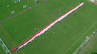 PLEASE BYLINE STEADYHAWK LTD<br /> Pictured: An aerial picture showing the actual scrum attempt under way in Cardiff, Wales, UK. Wednesday 24 August 2016<br /> Re: The largest rugby scrum has been achieved by Golden Oldies at University Fields in Cardiff south Wales, UK. It was refereed by welsh international referee Nigel Owens. Guinness World Records has verified the new record in which 1297 people took part in.