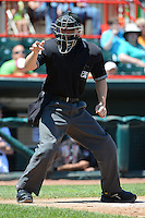 Umpire Chris Tipton makes a call during an Erie Seawolves game against the New Britain Rock Cats on June 20, 2013 at Jerry Uht Park in Erie, Pennsylvania.  New Britain defeated Erie 2-0.  (Mike Janes/Four Seam Images)