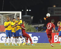 On a direct kick, Portugal defender Bruno Alves (2) pushes the wall, Brazil defender Maicon (15), Brazil defender Thiago Silva (3), and Brazil forward Jo (21). In an international friendly, Brazil (yellow/blue) defeated Portugal (red), 3-1, at Gillette Stadium on September 10, 2013.