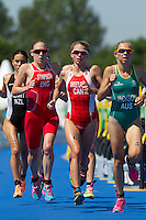 24 JUL 2014 - GLASGOW, GBR - The front pack on the run of Andrea Hewitt (NZL) (left) of New Zealand, Jodie Stimpson (ENG) (second from the left) from England, Aileen Reid (NIR) (third from the left, partly hidden) from Northern Ireland, Kirsten Sweetland (CAN) (third from the right) from Canada, Vicky Holland (ENG) (hidden) from England and, Emma Jackson (AUS) (right) from Australia run past transition for the start of their second run lap during the elite women's 2014 Commonwealth Games triathlon in Strathclyde Country Park in Glasgow, Scotland  (PHOTO COPYRIGHT © 2014 NIGEL FARROW, ALL RIGHTS RESERVED)<br /> *******************************<br /> COMMONWEALTH GAMES <br /> FEDERATION USAGE <br /> RULES APPLY<br /> *******************************