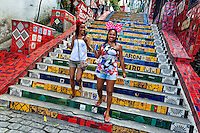 Girls go down the Selaron's Stairs (Escadaria Selarón), a mosaic staircase made of colorful tiles, in Rio de Janeiro, Brazil, 12 February 2012. World-famous staircase, mostly covered by vibrant yellow, green and blue tiles (inspired by the colors of the Brazilian flag), is the masterpiece of Chilean-born artist Jorge Selarón who considers it as a personal tribute to the Brazilian people. Connecting the neighborhoods of Santa Teresa and Lapa, the stairway is made up of 250 steps and measures 125 meters long. In 1990 Selarón began work on the stairway, creating a constantly evolving piece of art, now adorned with over 2,000 brightly colored tiles collected from over 60 countries. Selarón funds his one man's project through donations and the sale of his black-and-red paintings which mostly depict a pregnant African woman or himself. Living his passion, the eccentric 65-year-old artist claims that this crazy and unique dream will only end on the day of my death.