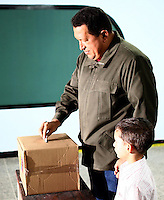 President of Venezuela Hugo Chavez cast his ballot in a school in Western Caracas during the national referendum to aprove or reject his constitutional reform that will allow him to be presidential candidate for endless terms.