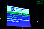 Text donations are posted on the screen during the gala at Cipriani.