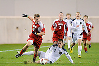 Colin Rolfe (9) of the Louisville Cardinals gets past a tackle by Jeb Brovsky (5) of the Notre Dame Fighting Irish. The Louisville Cardinals defeated the Notre Dame Fighting Irish 1-0 during the semi-finals of the Big East Men's Soccer Championship at Red Bull Arena in Harrison, NJ, on November 12, 2010.