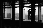 A couple shares a moment at 116th Street Station in New York City.