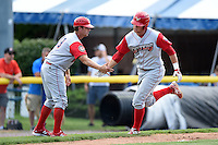 Williamsport Crosscutters first baseman Rhys Hoskins (12) is congratulated by manager Shawn Williams (10) after hitting a home run during a game against the Batavia Muckdogs on July 27, 2014 at Dwyer Stadium in Batavia, New York.  Batavia defeated Williamsport 6-5.  (Mike Janes/Four Seam Images)