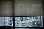 A window half covered with a curtain, Kolkata India. Arindam Mukherjee