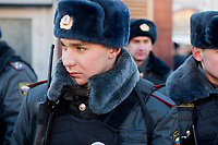 Police stand at the edges of Lubyanka Square during an unsanctioned anti-Putin demonstration in Moscow, Russia.  Police arrested a number of protesters and opposition leaders.