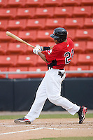 Jared Bolden #22 of the Hickory Crawdads follows through on his swing versus the West Virginia Power at L.P. Frans Stadium August 9, 2009 in Hickory, North Carolina. (Photo by Brian Westerholt / Four Seam Images)