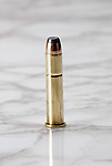 Bullet on marble surface