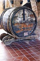 Ancient medieval oak vat on an old cart. Codorniu, Sant Sadurni d'Anoia, Penedes, Catalonia, Spain