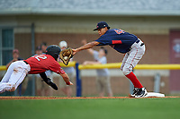 Lowell Spinners first baseman Ricardo Cubillan (44) stretches for a throw as J.D. Orr (22) gets back to the bag during a NY-Penn League game against the Batavia Muckdogs on July 11, 2019 at Dwyer Stadium in Batavia, New York.  Batavia defeated Lowell 5-2.  (Mike Janes/Four Seam Images)
