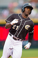 Jared Mitchell (21) of the Charlotte Knights hustles around the bases on is way to an inside-the-park home run against the Pawtucket Red Sox at BB&T Ballpark on August 9, 2014 in Charlotte, North Carolina.  The Red Sox defeated the Knights  5-2.  (Brian Westerholt/Four Seam Images)