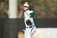 Tyler Barnette #18 of the Charlotte 49ers makes a pick-off throw to first base against the Tennessee Tech Golden Eagles at Robert and Mariam Hayes Stadium on March 8, 2011 in Charlotte, North Carolina.  Photo by Brian Westerholt / Four Seam Images
